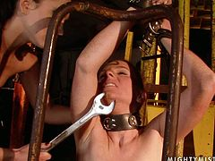 This redhead with small tits is securely tied to a frame by horny mistress. She is helpless and ready for any sex tortures. Check out this hot BDSM sex video and I'm kinda sure you will enjoy watching it.