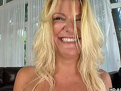Even after all these years this blonde mature woman's tits still look great. She gives you a nice view of her melons and covers them in oil. Her man comes along and rubs her luscious boobs before getting his rock hard cock sucked. She likes it when you watch her suck dick.
