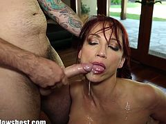 Red head MILF messy with cum after sucking that huge young cock deep inside her jizz hungry mouth.