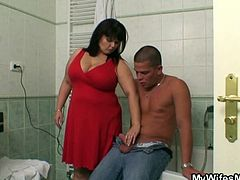 Horny guy is caught by his plump mother-in-law in the batrroom as he was jerking off. She likes his cock and doesn't think twice before helping him cum.