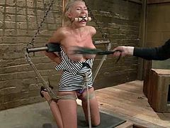 Busty blonde skank Katie Summers allows some guy to bind and suspend her in a basement. The man beats Katie with a lash and then pokes his fingers deep into her juicy cunt.