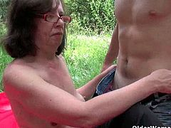 Jana is a dirty granny who lures young men while laying outdoors. She sucks off this guy's stiff rod and then she takes it in her hairy ass hole. He cums on her saggy tits.