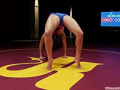 Sporty brunette chick in sportswear shows how she stretches and prepares for a fight. She does some acrobatic pirouettes and push-ups.