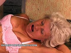 This sex-starved grannie loves a good, hard fuck! Horny stud pounds her tight butthole from behind making her moan with pleasure. Then she gets into sideways position to let him control the penetration.
