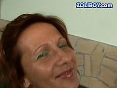 Skanky mature brunette woman is stripping in front of the camera exposing her fine figure. Then she gets down on her knees serving her mouth while perverted dude is pissing onto her.