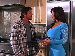 One of a kind black haired milf Lisa Ann with gigantic gazongas and round ass in tight blue dress seduces neighbor and has memorable oral session in the kitchen.