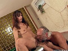 Kinky woman is seduced by old daddy for sex. He suckles her nipples so she turns on as hell. Brunette trollop kneels down to give deepthroat blowjob. After she bends over the table getting rammed bad doggy style.