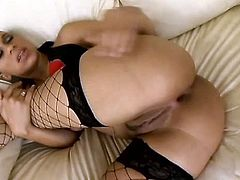 Kinky ebony brunette in fishnet stockings goes nuts about a tough anal fuck. Kinky nympho with natural tits moans while getting her asshole polished properly on the couch. Then this bitch gives a super solid blowjob to be fed with sticky sperm.