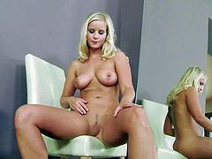 Marry Queen is one mouth-watering blondie with absolutely amazing big titties. She gets naked in front of the mirror and then rubs her snatch on a chair for your viewing pelasure. Busty Marry Queen is so sexy in this solo scene.