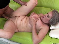 This dude knows how to satisfy this old woman's needs! He spreads her legs wide so he can lick her wet snatch. Then he pounds her hairy muff missionary style.