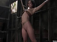 Tied up brunette girl gets her vagina drilled by a fucking machine. After that she gets humiliated and tortured in water.
