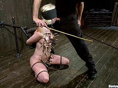 This smoking hot blond sex slave Cherry Torn is under some severe treatment! Honey gets tied up, blindfolded, twitched and gagged with James Deen's huge dick!