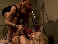 Ruined brunette slut gets enchained and her mouth gagged before a rapacious domina orders her suck a dildo and later uses it to poke her shaved pussy in BDSM-involved sex video by 21 Sextury.