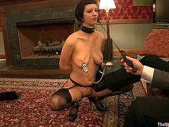 Kinky brunette milf Cherry Torn wearing sexy black stockings is having fun with some guy indoors. The dude whips and tortures the bitch and humiliates her in every manner.