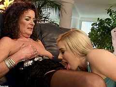 Too horny and too pale slim blondie Nesty is fond of having sex with spoiled mature dyke. Black haired fatso with saggy tits spreads legs wide to open her wet old pussy for cunnilingus right on the couch.