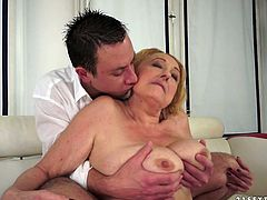 Ample mature BBW gets her big slack tits mauled from behind by aroused young fucker before she lies with legs wide open to allow him tongue fuck her bald vagina.