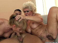 These lustful lesbians know how to get this dude's attention. They give pleasure to each other in 69 position and then they show their cock sucking skills.