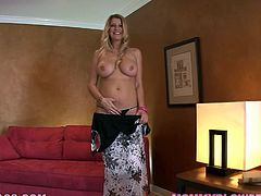 Stunning blonde MILF takes the dress off and shows her hot pussy. Later on she lies down on the floor near the guy and starts to suck his big cock.