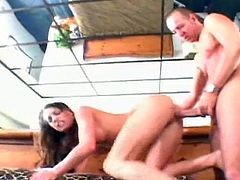 This brunette with big perky tits gets to play with a big cock and a toy at the same time. This guy fills her butt hole with his cock and she fills her pussy with a dildo.