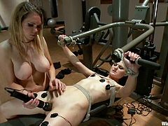 I've never seen a BDSM session in a gym where one of the girls is forced to workout while being tortured and toyed by the other one.