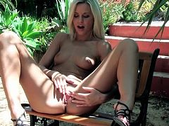Lovely Lola Myluv fingers her cunt outdoors