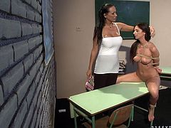 Kinky teacher bandages her fresh faced brunette student and forces her lie on the desk to allow her take a thorough look on her cuddly body in peppering sex video by 21 Sextury.