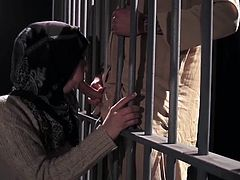 Hot arab babe enjoys a large dick by sucking it while in the prison