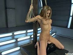 Cute blonde milf Kayla Carrera is having fun indoors. She demonstrates her big tits and then gets her coochie pounded by a fucking machine.