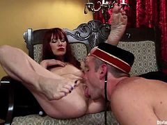 Naughty Maitresse Madeline orders John Jammen to lick her feet and he obeys happily. Then she lifts her skirt up and he starts to lick her vagina.