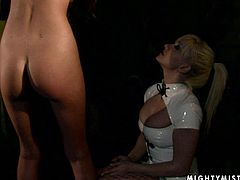 Svelte blond cutie gets suspended while a sophisticated domina in sultry nurse costume slaps and mauls her round firm ass in sizzling hot BDSM-styled sex video by 21 Sextury.