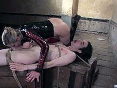 Slim chick in latex ties up a guy and whips him with a stick. After that she destroys his asshole with a strap-on. Then she also sucks his dick excitedly.