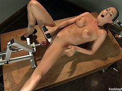 Adorable brunette with slim body takes her clothes off and lies down on a table. Then she gets her soaking pussy drilled by the fucking machine.