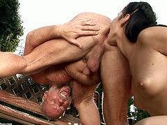 Lascivious brunette hottie hops on a hard cock in cowgirl style outdoor before she sits on the bench with a kinky grey-haired grandpa lying under her to welcome riming from him.