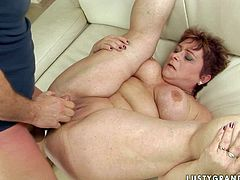 Immense red-haired mature spreads her thick legs wide while an insatiable daddy fists her stretched pussy and later fucks it missionary style in steamy sex video by 21 Sextury.