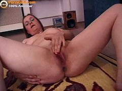 This long haired mature strips off her regular clothes and reveals her huge natural tits. Next she shows off her bald pussy and starts to masturbate by fingering it.