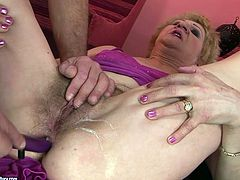 Ample blond mature spreads her tights aside allowing a horny grey-haired lover finger fuck and stimulate her bushy pussy with sex toys in steamy sex video by 21 Sextury.