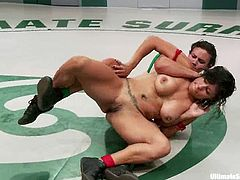 Two brunette chicks fight in Ultimate Surrender battle. After that the winning chick toys the losing one with a strap-on.
