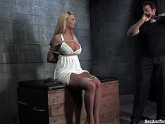 Big-breasted blonde Phoenix Marie gets bound by Steven St. Croix in a basement. Steve makes Marie suck his dick and then brutally fucks the girl's delicious pussy.