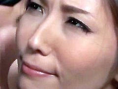 Asian slut sucking cock and getting fucked with a vibrator