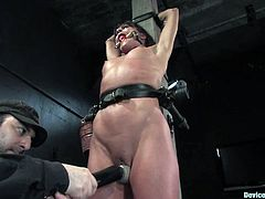 Cute brunette milf Cecilia Vega is having fun with some brutal dude in a basement. The man puts the bitch into fetters, pours scorching wax on her tits and then makes her jump on a fucking machine.