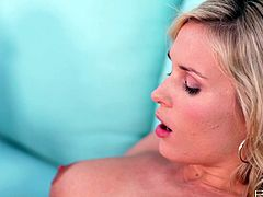 Charming blonde Laura Crystal is getting naughty outdoors. She takes her clothes off and demonstrates her body and then sits down on a sofa and begins to play with her pussy.