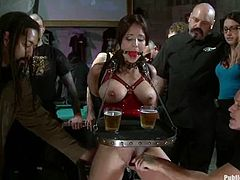 Everything is happening in public and that is no concern for this busty sex slave. Babe enjoys some tight bondage and then gets to suck some dicks with a hook in her asshole.