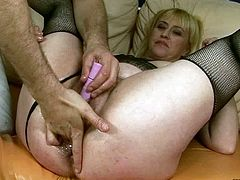 This dude wants to get really wild with this slut's twat. He drills her snatch with various sex toys to make it wet and ready. Then he fists her hairy snatch hard.