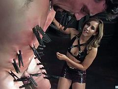 Brown-haired cutie Bobbi Starr and her pretty GF are having BDSM fun with a guy called Eddy. They attach clothes pegs to his body and pour hot wax on his back and then suck his dick and smash his butt with a strapon.