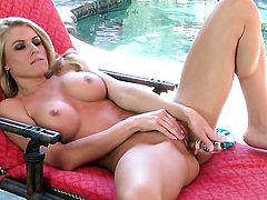Randy Moore with big hooters and trimmed snatch puts sex toy in her pussy hole