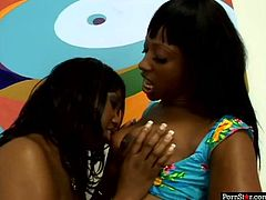 Naughty black MILFs are caressing one another stripping seductively. Then the one with apple bottom stands on her all four exposing her junk. The other girl rubs ample booty with oil.