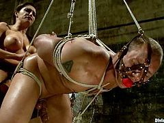 Francesca Le is going to strapon fuck a guy in a bondage session where she shows him who the boss really is. Femdom at its best.