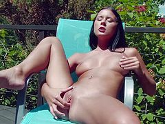 Mia Manarote is a dark haired young chick with small sexy ass and tight pussy. She strips down to her bare skin and fingers her pink twat under the open sky. Watch Mia Manarote play with her snatch.