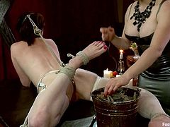 Hot brunette babe gets tied up by her blonde mistress. Then Veruca licks Aiden's feet. Later on Aiden starts to shove her feet in Veruca's vagina.