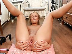 Blonde Betsy needs nothing but a dildo in her twat to get satisfaction